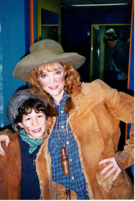 Crystal Bernard (Annie) and Nicholas stop for a hug - credit nicholasjonas.com