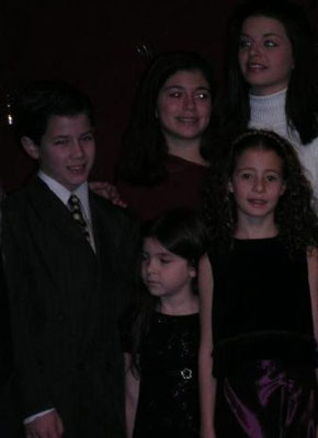 Nick with 'The Sound of Music' kids (only Caroline London, Krista Pioppi, Tiffany Giardina, and Elizabeth Lundberg shown). December, 2003 at a Benefit Holiday Concert for the Paper Mill Playhouse in New Jersey