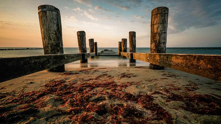 Sonnenuntergang an der Ostseeküste am Strand von Kühlungsborn