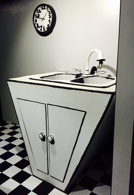 black and white kitchen sink meow wolf