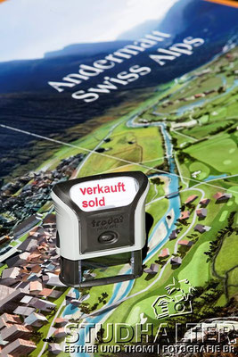 Stempel 'Verkauft - sold' im Sales and Info Center beim Bahnhof Andermatt (The Chedi Hotel).