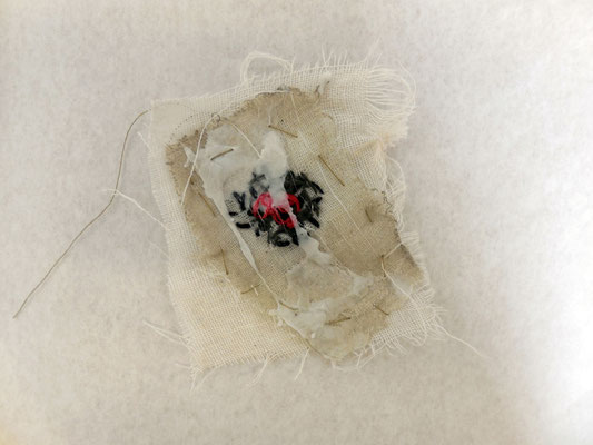 test sample with polystyrene over embroidered muslin