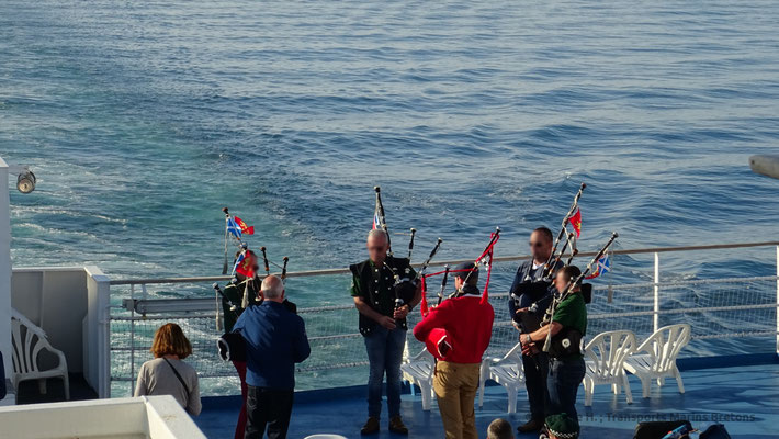 A band playing back pipes on the aft sun deck of Normandie