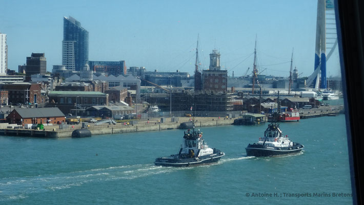 Two tug boats escorting Normandie out of Portsmouth