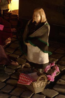 Magret, die Wäscherin hat von IHREM PILOTEN wieder ihre Orchidee erhalten (Milieukrippe in Sankt Maria in Lyskirchen, Foto © lyskirchen)