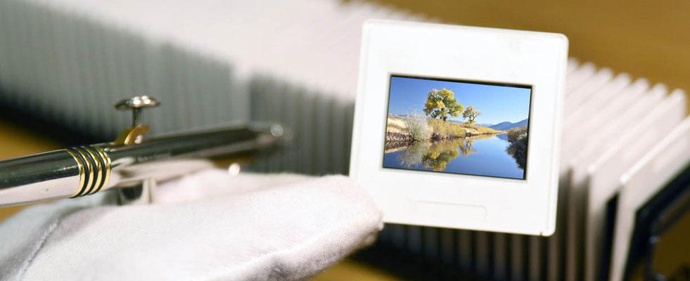 Nur bei uns: Druckluftreinigung Ihrer Dias, Negative und Fotos im Festpreis je Bild enthalten