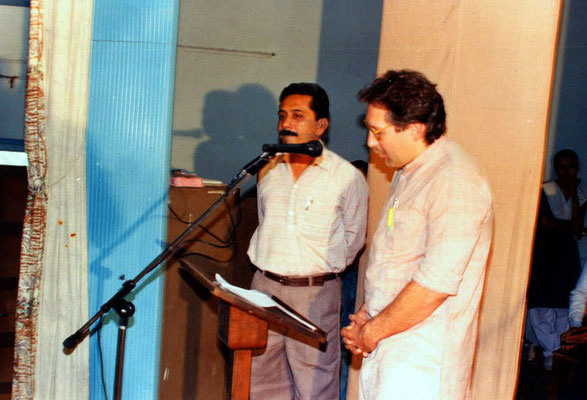 "Peter Rühe delivering a speech in Gujarati during the prize distribution function of the second drawing competition ""Mahatma Gandhi – As I See Him"" at Rajkot, 1992. Left: Peter's friend Yogesh Goda"