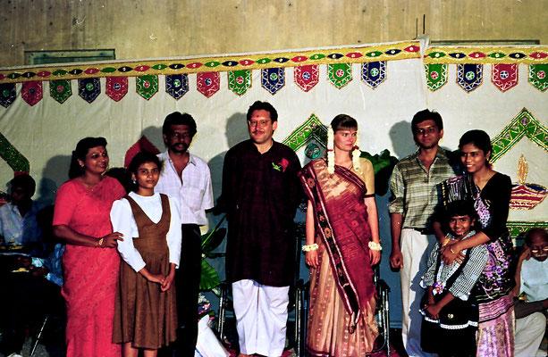 The newly wed couple posing with well-wishers during a reception at Rashtriyashala Ashram, Rajkot, Gujarat, 1994.