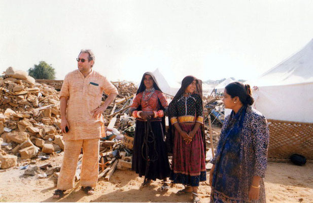 Peter Rühe with surviving women in traditional dresses of the Gujarat Earthquake, 2001