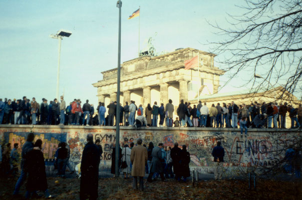 The day before the Berlin Wall fell: West-Berliners occupy the wall near Brandeburg Gate, 1989.