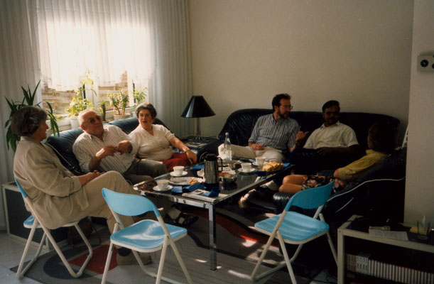 With parents, friend Ravinder and colleagues, Berlin, 1990.
