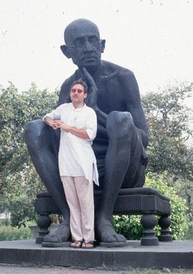 In front of a Gandhi statue on the Gandhi Sangrahalaya campus, Delhi, 1994.
