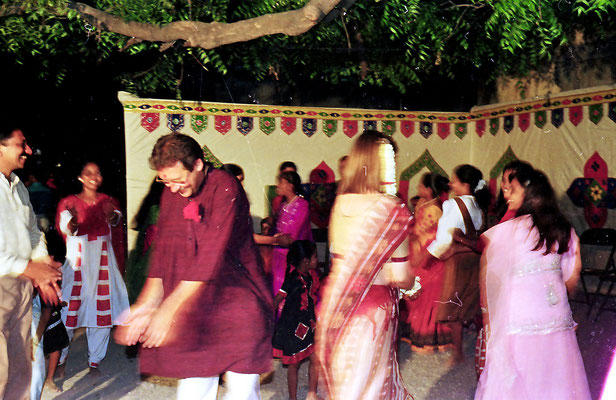 The newly wed couple dancing a traditional Gujarati dance, Ras/Garbar, during a reception at Rashtriyashala Ashram, Rajkot, Gujarat, 1994.