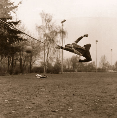 The goalkeeper in action, during a practice, 1975.