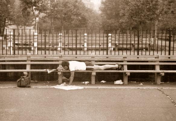 Reading newspaper in Manhatten, 1981.