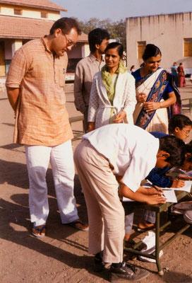 """During the first drawing competition """"Mahatma Gandhi - As I see him"""" at Kadvibhai Virani Kanya Vidyalay (KVKV) with teachers and participants in Rajkot, Gujarat, 1991."""