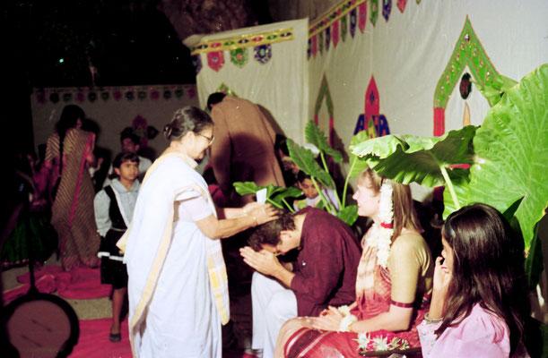 The newly wed couple receiving blessings from Abhabehn Gandhi during a reception at Rashtriyashala Ashram, Rajkot, Gujarat, 1994.