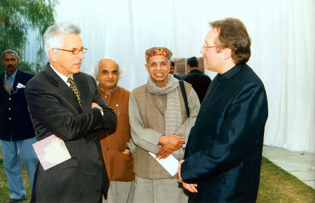 "Peter Rühe talking with German Ambassador, Heimo Richter, during the release of his photo biography ""Gandhi"" at the India International Centre, Delhi, 28 January 2002"