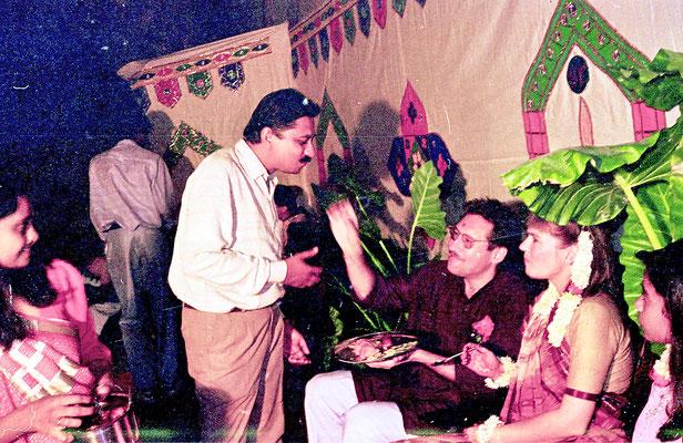 The newly wed couple receiving blessings from Yogeshbhai Goda and his wife Sarojbehn during a reception at Rashtriyashala Ashram, Rajkot, Gujarat, 1994.