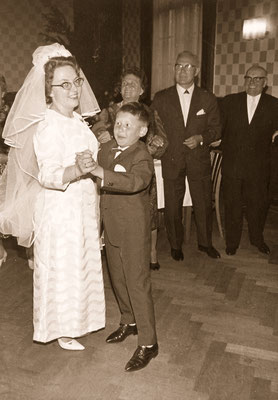 Dancing with his godmother during her wedding, 1965.
