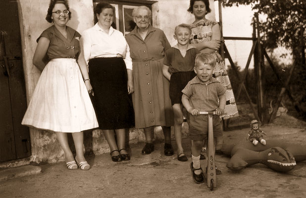 With both grandmothers and mother (right), 1960.