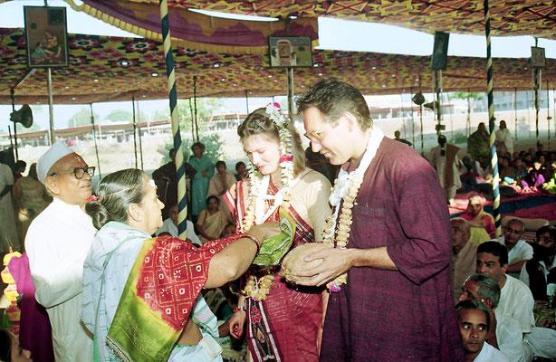 Bride and groom receiving blessings and presents from veteran freedon fighters during the Sarvodaya Sammelan, Savarkundla, Gujarat, 1994.