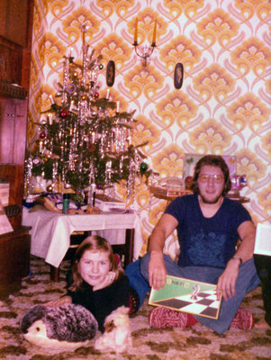 With sister Corinna under the Christmas tree, 1974.