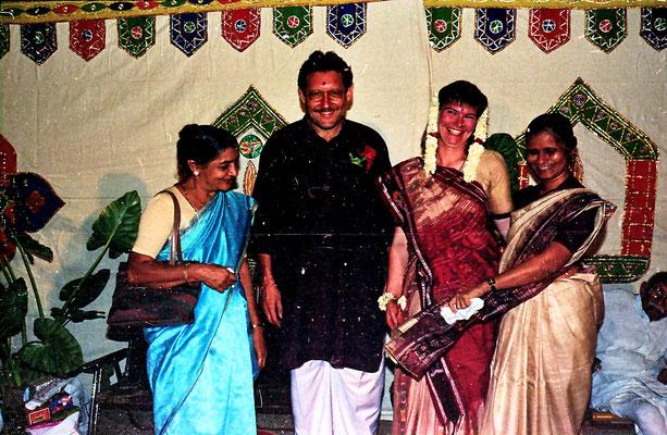 The newly wed couple posing with friends during a reception at Rashtriyashala Ashram, Rajkot, Gujarat, 1994.