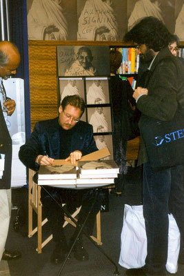 Peter Rühe signing his photo biography during Frankfurt Book Fair, 2001. Left: Dr. Joseph Prabhu