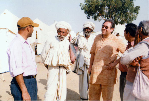 Peter Rühe talking with surviving men in traditional dresses after the Gujarat Earthquake, 2001