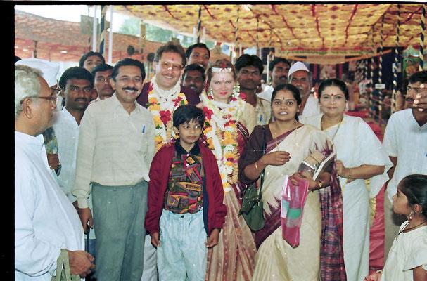 Bride and groom with friend Yogeshbhai Goda and his family, Savarkundla, Gujarat, 1994.