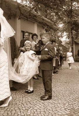 During the wedding of his godmother, 1965.