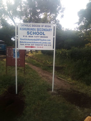 Advertising signs for Kishumundu Secondary School at Moshi round about exit to Rau and in Mamboleo.