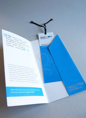 Flyer für die Buchmesse mit einem Lesezeichen