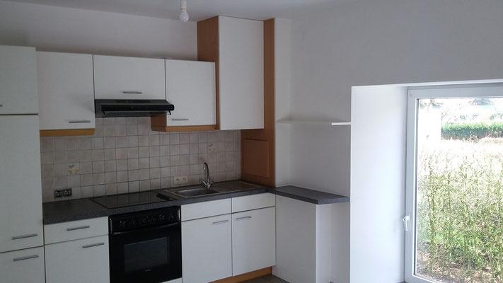 Aménagement d'un coin cuisine, après le remplacement d'un chauffe-eau.