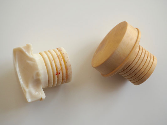 2 - The original synthetic ivory plug and the new boxwood one