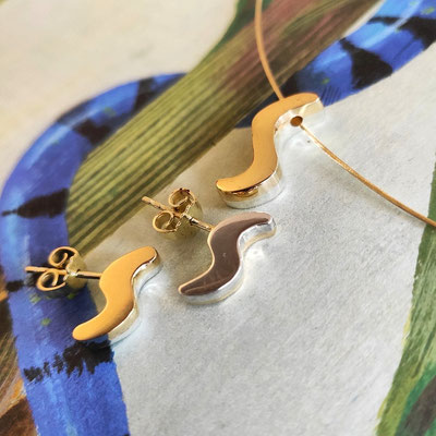 Set oorstekers en hanger van goud en zilver