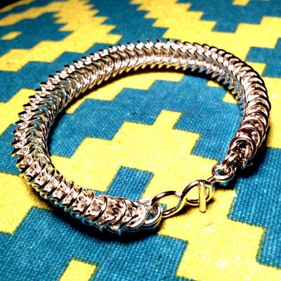 Zilveren oogjesarmband, koningsschakel