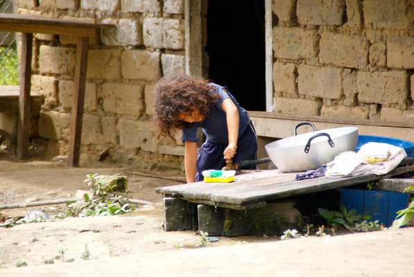 Little girl filling water.
