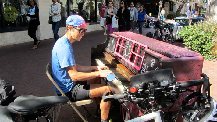 Playing piano in the streets of Santa Barbara.