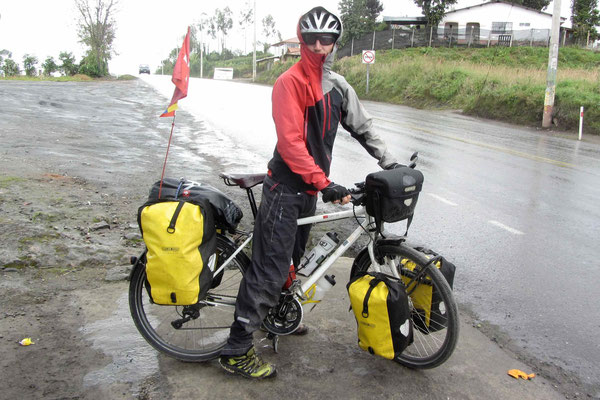 Sam on a 3300 meter pass after Tulcan. For the first time after California we use our rain pants.