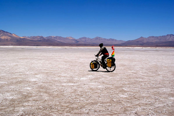 Riding on the salar only for the picture. The water stopped us soon.