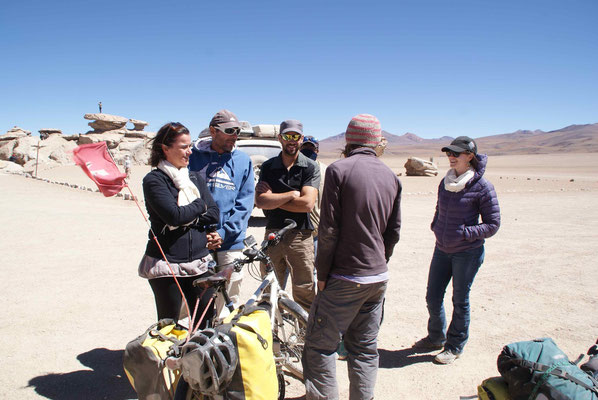 Tourists from Switzerland and France wondering what we are doing with our bikes in the desert.