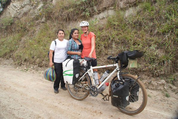 The women who help Flurina to push the bike up the steepest and muddiest hill ever.