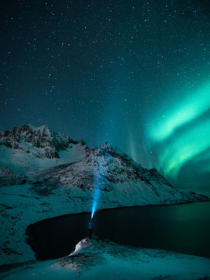 Using the headlamp to create an stunning scenery while the polar lights are dancing.