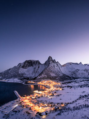 The lights of small village in Norway during the blue hour.