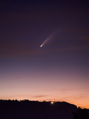 Comet Neowise above a hill in Switzerland.
