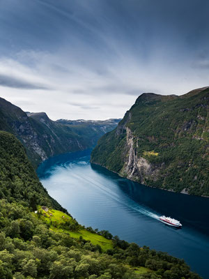 Fjord in Norway with a ship of the famous Hurtigruten.