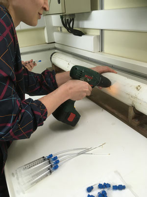 Puncturing the core to connect the fluid sampling tubes