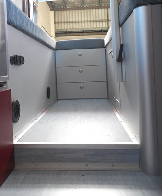 elevated rear area with ducting for hot air system and lagun table leg